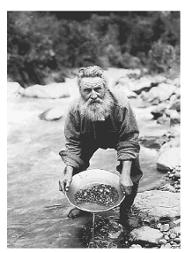 alaskan prospector panning (screening) for gold